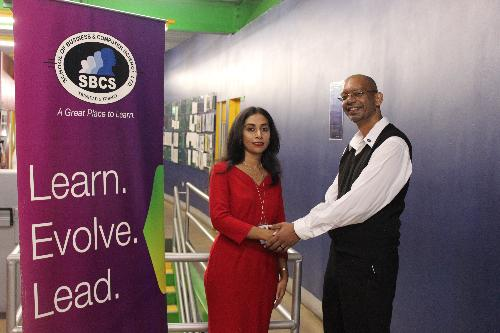 Ms Yacub is congratulated by her lecturer Mr Karmalain Manohar