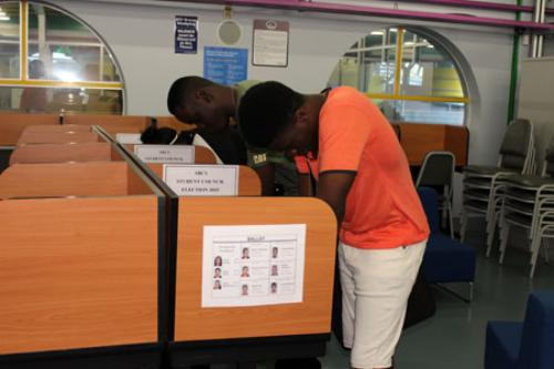 Students completing their ballots
