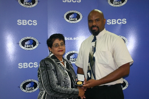 Local City and Guilds Representative, Sue Carlton presents medal to SBCS student Garth Maundy