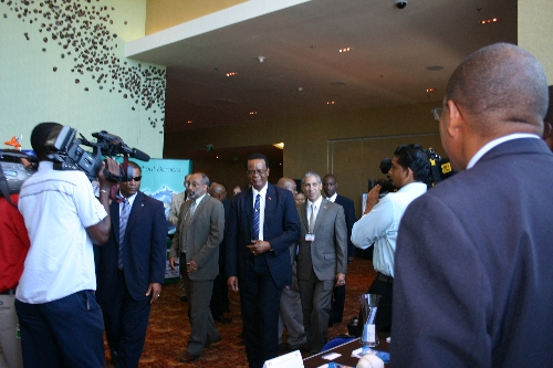 Acting Prime Minister, Errol Mc Leod and AMCHAM President Simon Aqui arrive at the HSSE Conference to view the booths